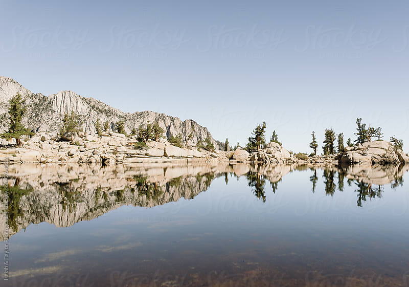 Mountain reflection by Isaiah & Taylor Photography for Stocksy United