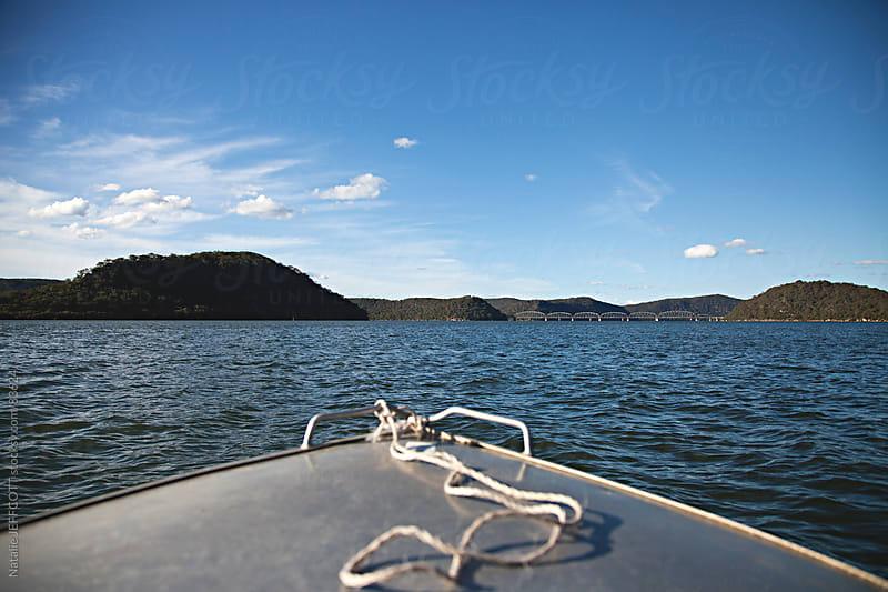 boat on river by Natalie JEFFCOTT for Stocksy United