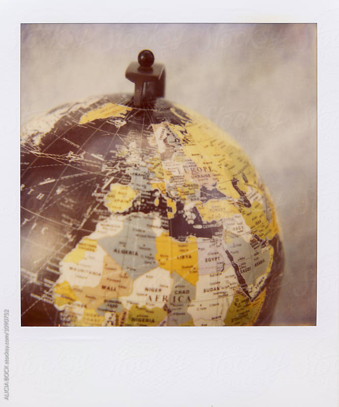 A Black Globe Photographed With Expired Polaroid Film by ALICIA BOCK for Stocksy United