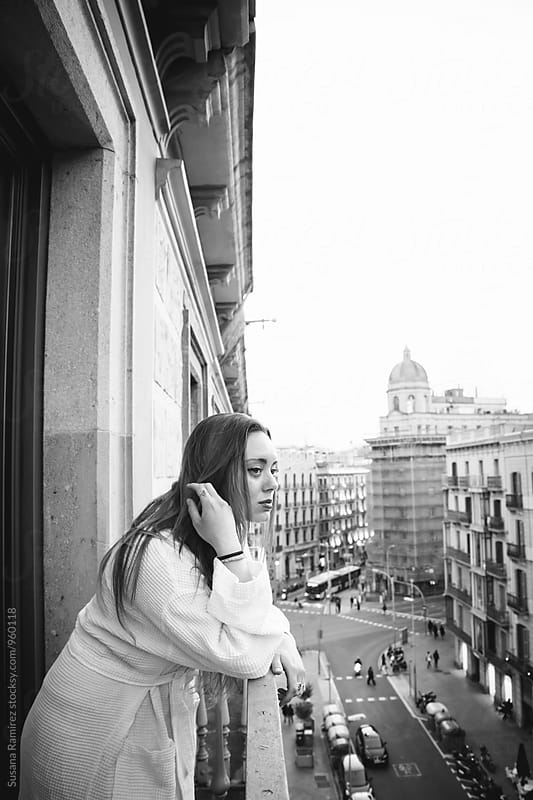 Portrait of woman on the balcony with bathrobe by Susana Ramírez for Stocksy United