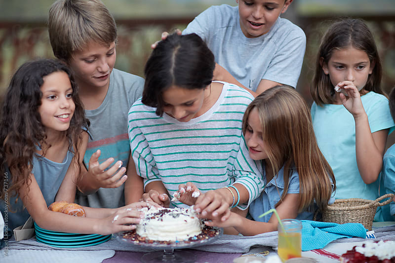 Birthday cake war and children by Miquel Llonch for Stocksy United