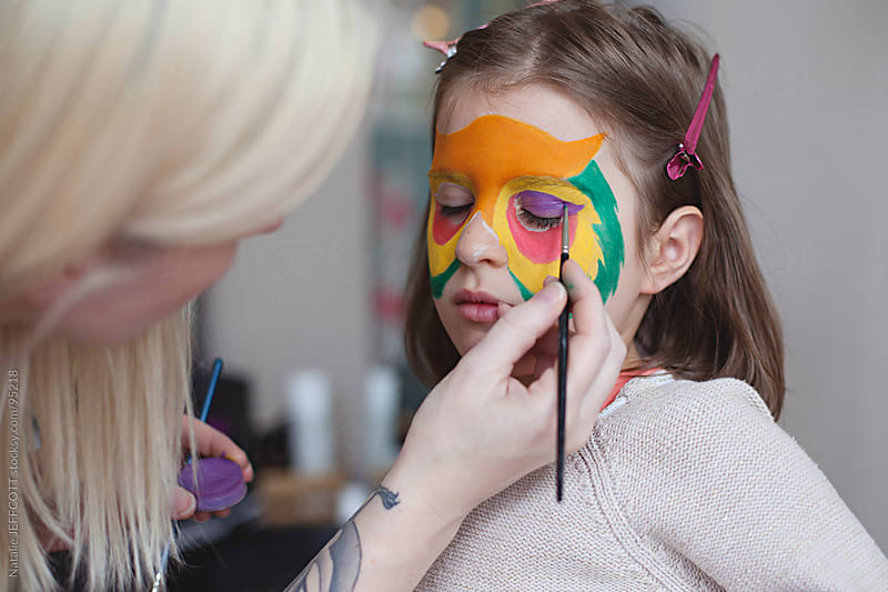 getting face painted for Halloween by Natalie JEFFCOTT for Stocksy United