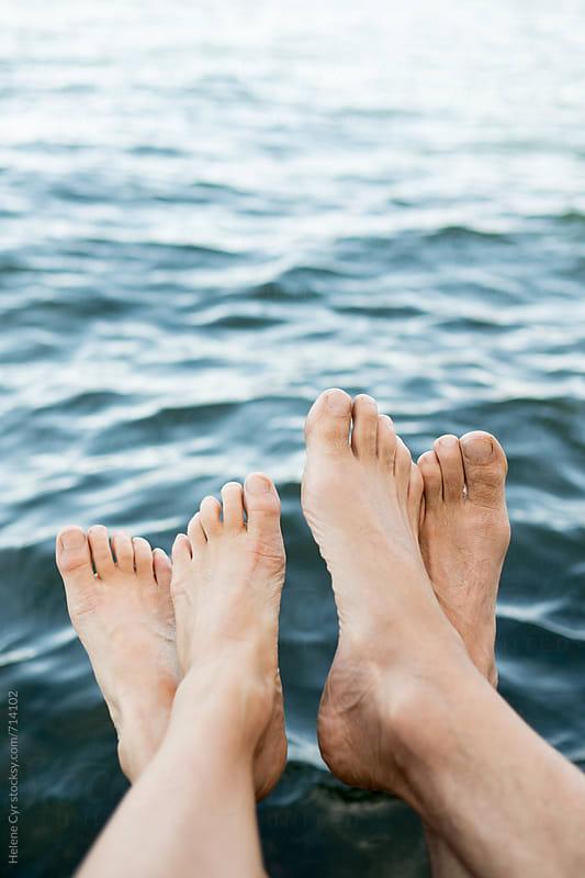 Feet near water by Helene Cyr for Stocksy United