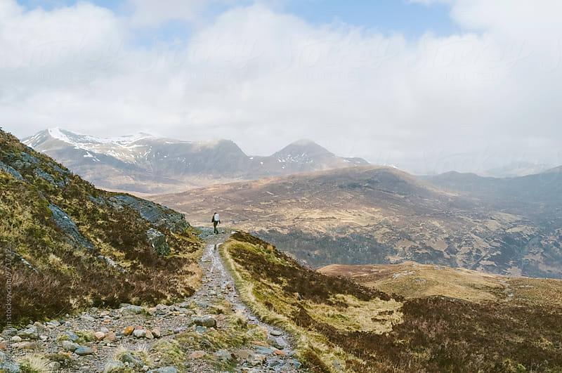 A lone hiker or walker overlooking the Scottish Highlands. by Ivo de Bruijn for Stocksy United