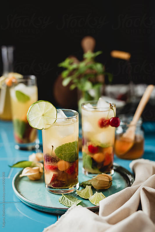 Mint ice tea with fruits by Tatjana Zlatkovic for Stocksy United