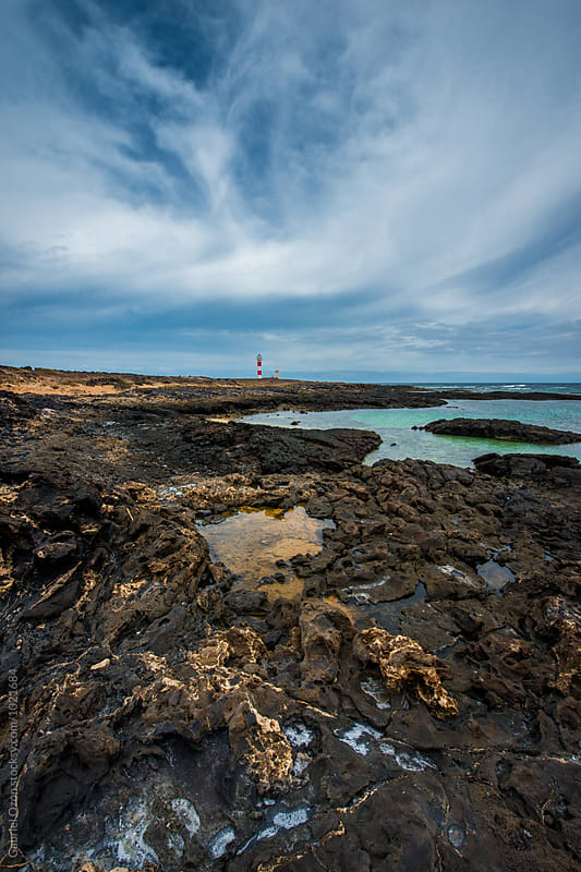 El Cotillo with a view to Tostón Lighthouse by Gabriel Ozon for Stocksy United