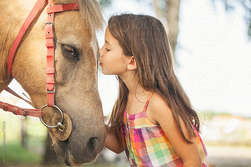 Cute Girl Kissing a Horse by Lumina for Stocksy United