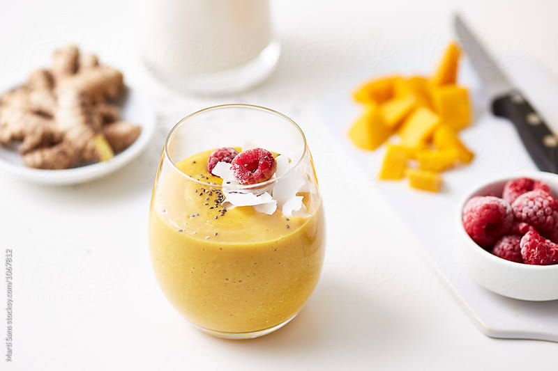 Fruit yellow smoothie in glass by Martí Sans for Stocksy United