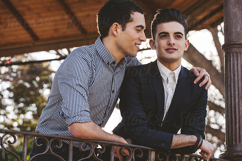 Portrait of a young gay couple on the park. by BONNINSTUDIO for Stocksy United