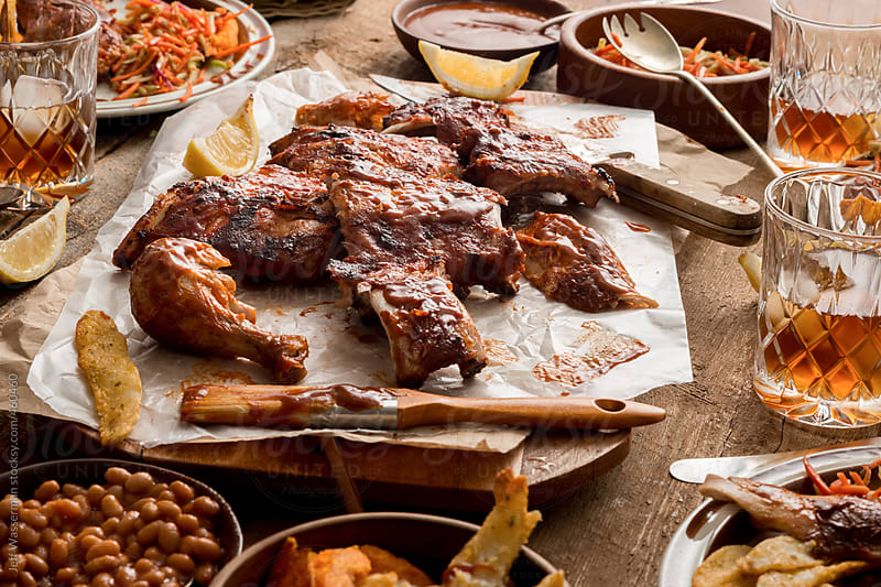 Messy Meal: Barbeque Ribs and Chicken by Studio Six for Stocksy United
