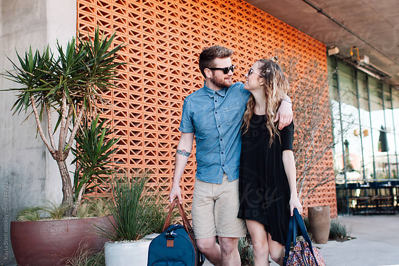 young couple on vacation by Kayla Snell for Stocksy United
