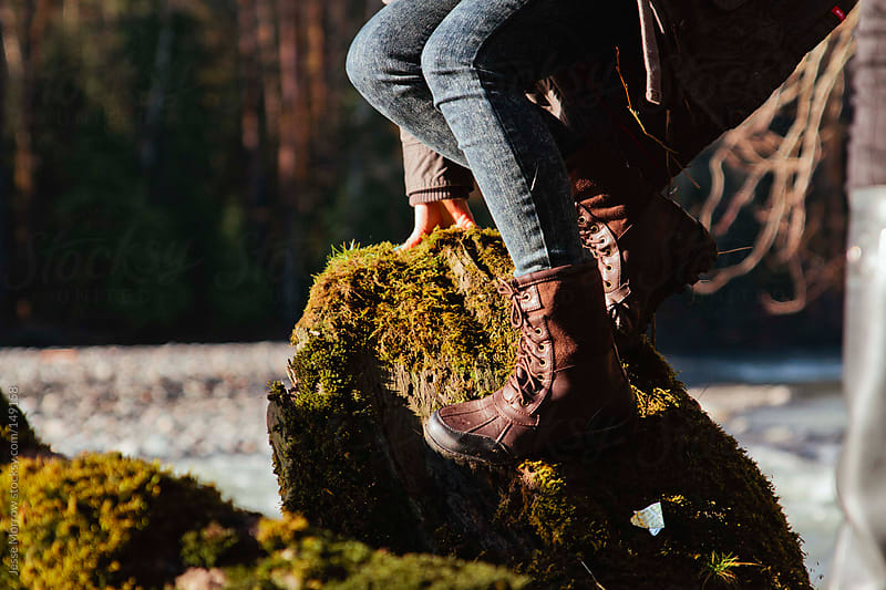 Boots on a fallen tree by Jesse Morrow for Stocksy United