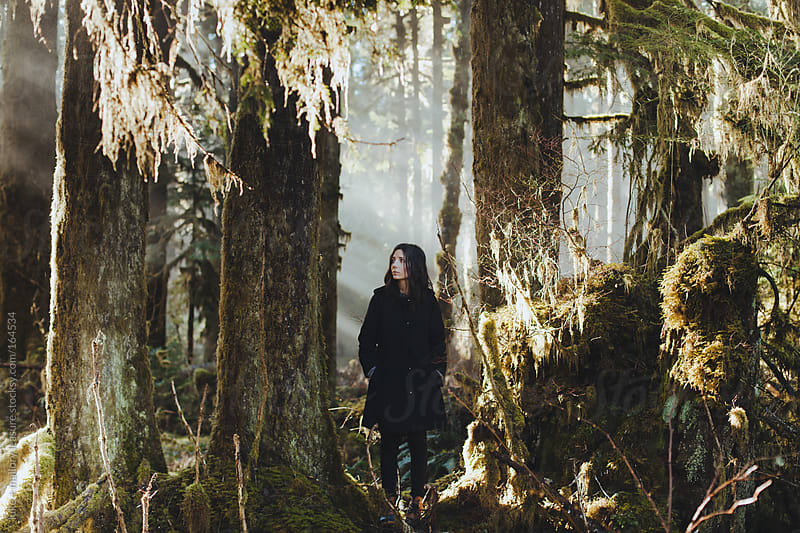 Girl in the woods by luke + mallory leasure for Stocksy United