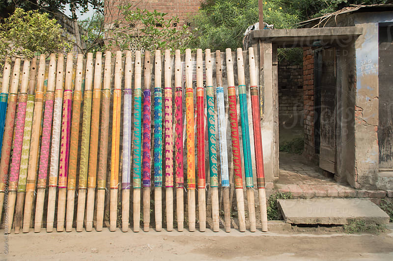 colorful saris drying in the sun by Gabriel Diaz for Stocksy United