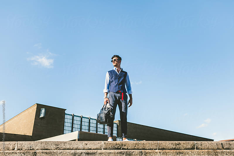 Modern Fashionable Commuter Standing Outdoors by Giorgio Magini for Stocksy United