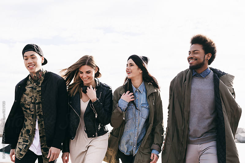 Portrait of group of friends having fun outside. by BONNINSTUDIO for Stocksy United