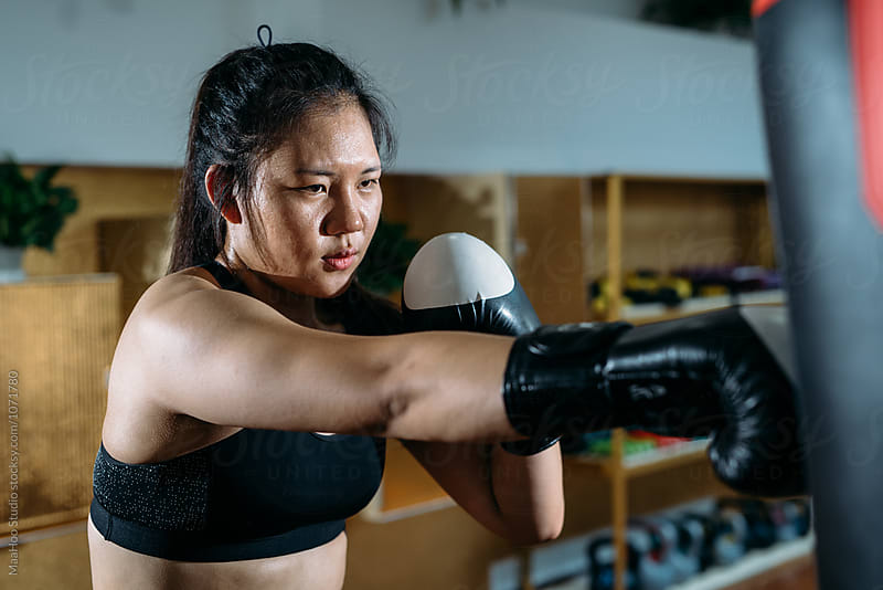 Young female boxer exerting in gym by MaaHoo Studio for Stocksy United