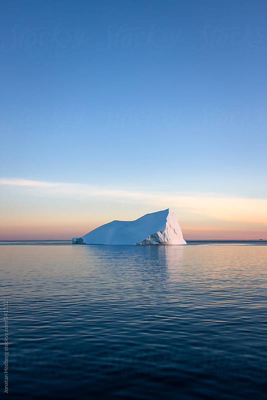 Iceberg in the sunset by Jonatan Hedberg for Stocksy United