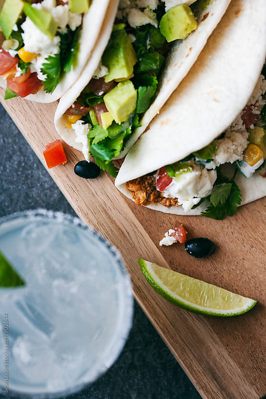 Tacos: Focus On Chicken Soft Tacos On Cutting Board by Sean Locke for Stocksy United