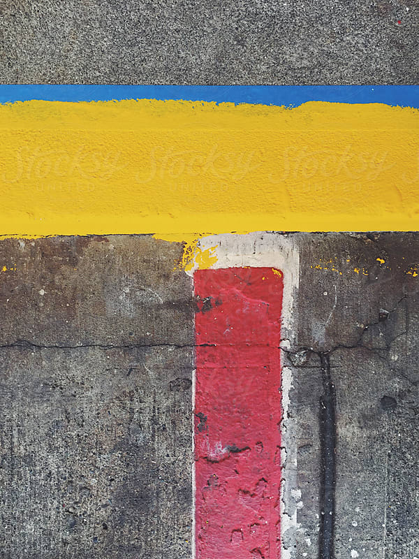 Brightly painted street curb, close up by Paul Edmondson for Stocksy United