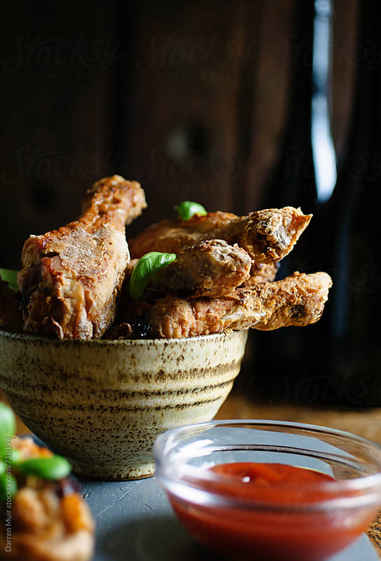 Fried chicken and barbecue sauce dip on a table. by Darren Muir for Stocksy United