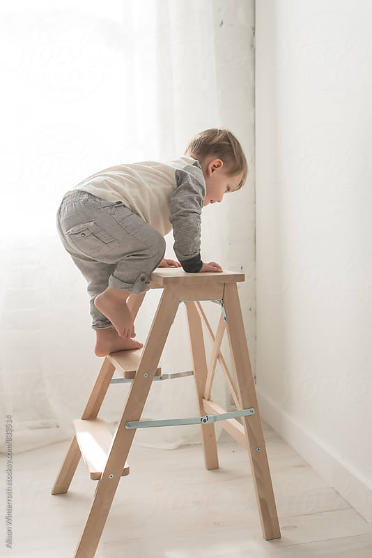 Boy Learning To Climb by Alison Winterroth for Stocksy United