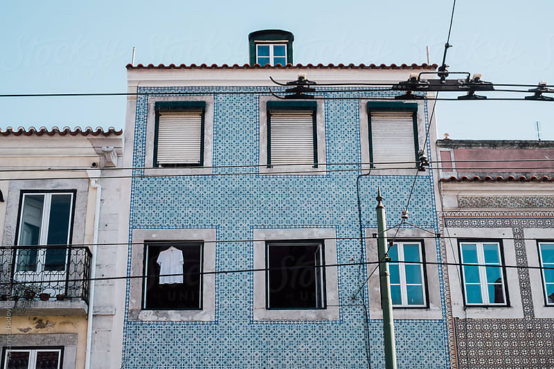 Building with Pastel Blue Tiles  by Katarina Radovic for Stocksy United
