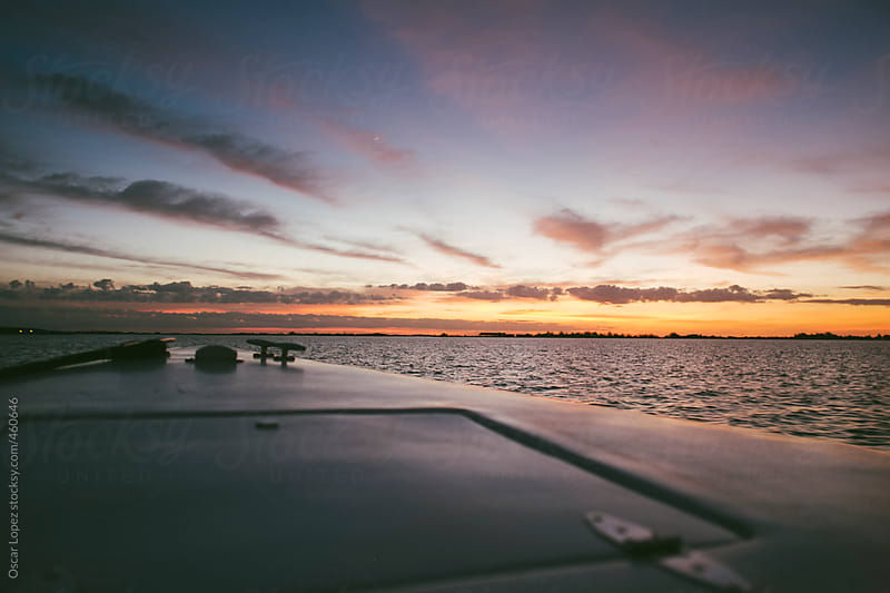 Sunset from a boat  by Oscar Lopez for Stocksy United