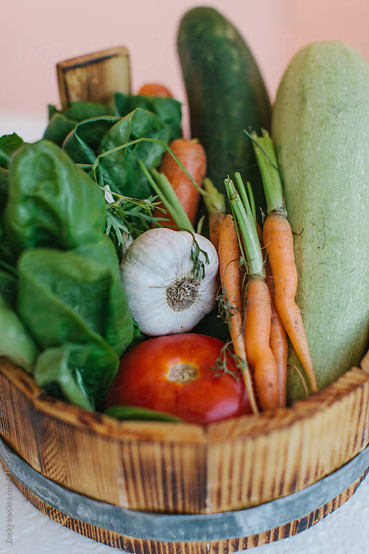 Wooden basket full of fresh organic vegetables by Zocky for Stocksy United