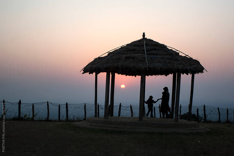Mother and daughter enjoying sunset in remote place by PARTHA PAL for Stocksy United