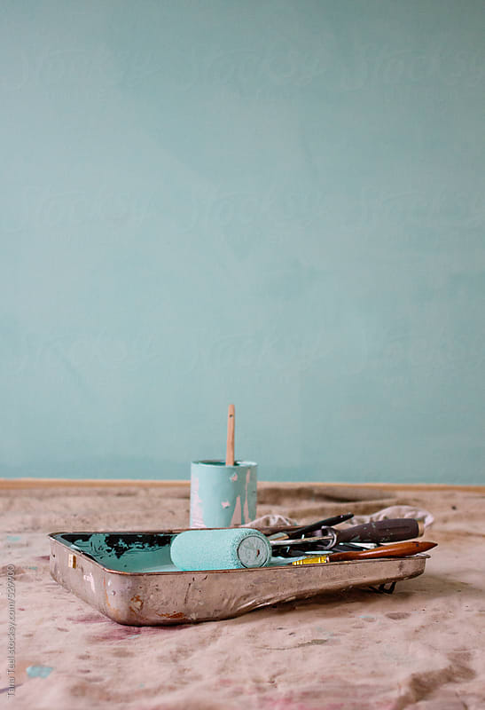 Painting implements sitting by freshly painted wall by Tana Teel for Stocksy United