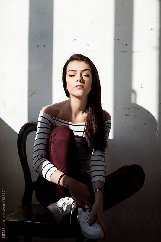 Portrait of a young female model by MEM Studio for Stocksy United