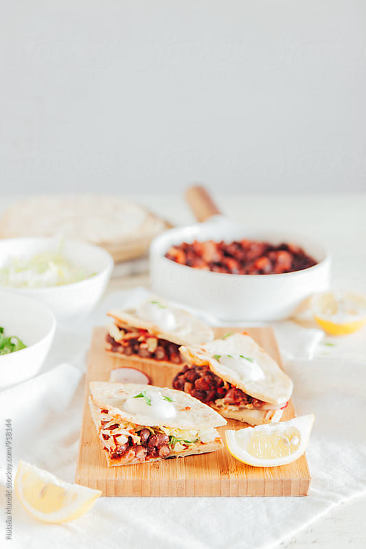 Tacos with azuki beans, salad and yogurt salsa by Nataša Mandić for Stocksy United