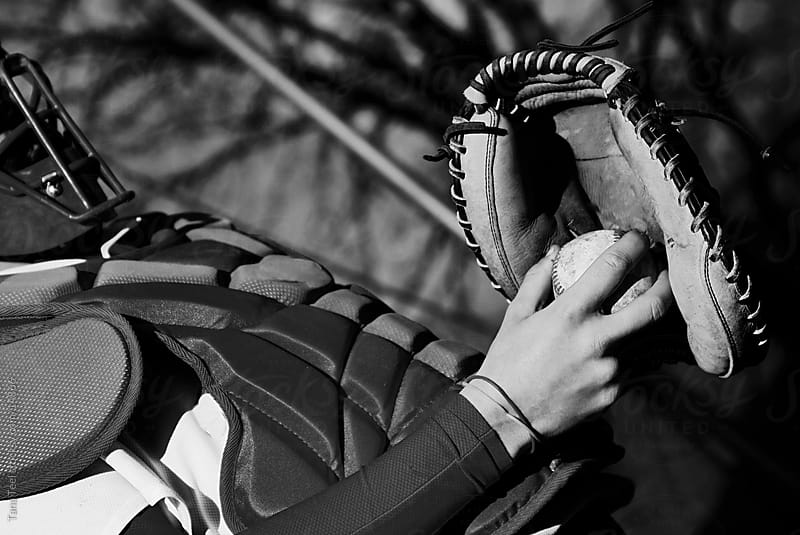 Catcher holding ball in his glove.  by Tana Teel for Stocksy United