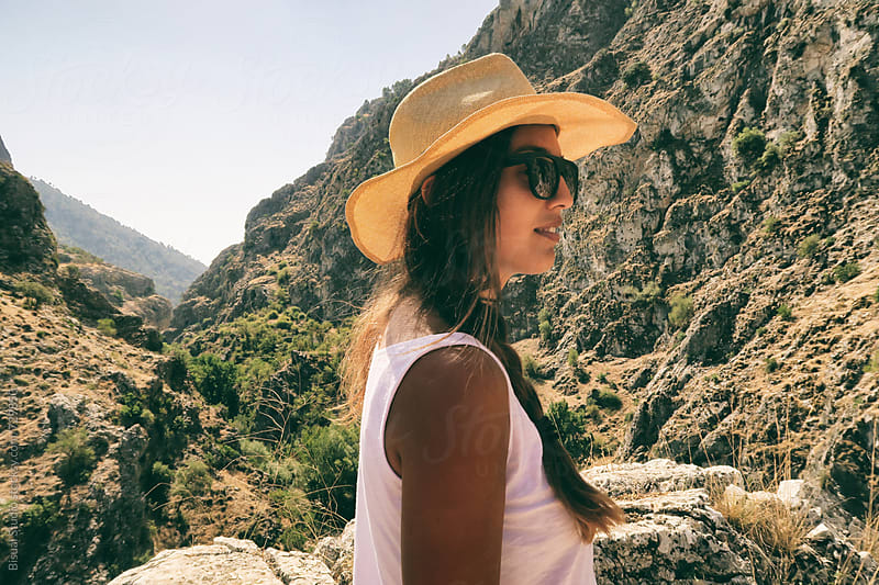 Young woman hiking in Moclin, Granada by Bisual Studio for Stocksy United