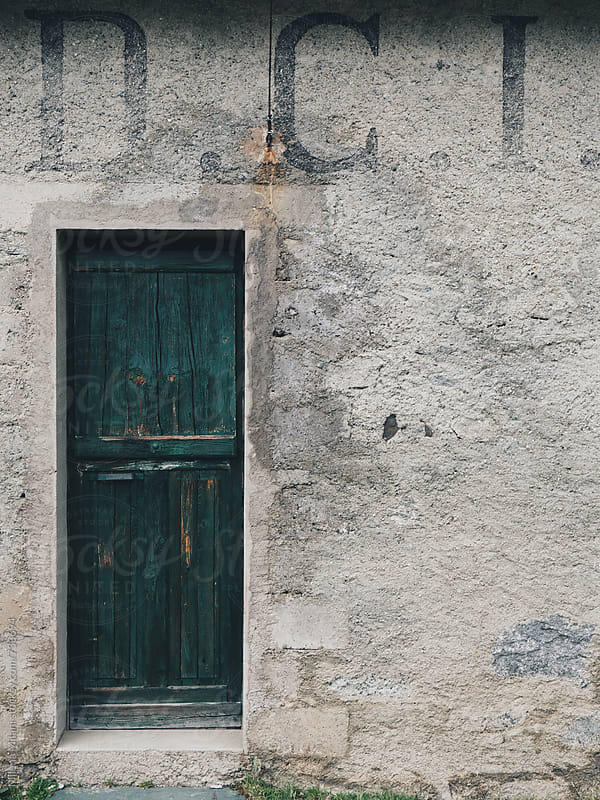Green door by Milena Milani for Stocksy United