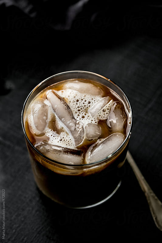Iced coffee and milk with ice cubes in it by KEMA Food Culture for Stocksy United