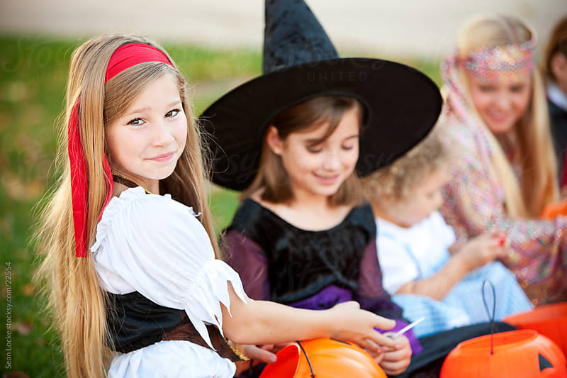 Halloween: Little Pirate Girl with Halloween Friends by Sean Locke for Stocksy United