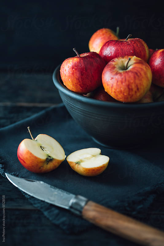Food: Organic apples in a bowl by Ina Peters for Stocksy United