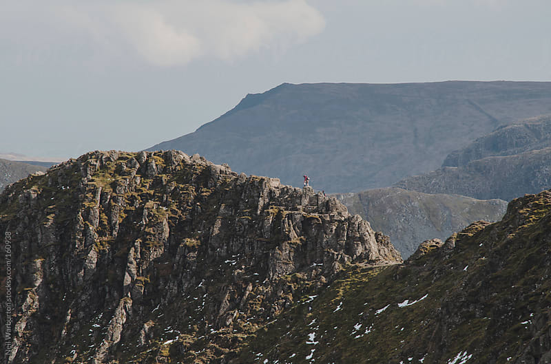 Hiker on a Ridge by Neil Warburton for Stocksy United