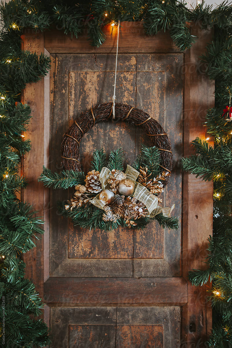 Christmas Wreath On An Old Wooden Door Stocksy United