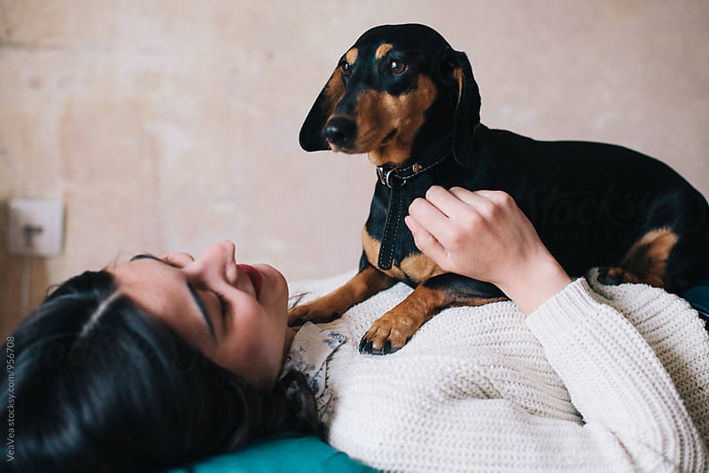 Portrait of a woman and her dog indoor by VeaVea for Stocksy United