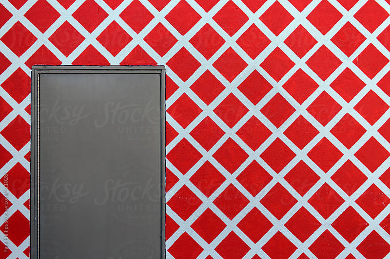 Red square and pattern by the exit of an industrial building by Paul Phillips for Stocksy United