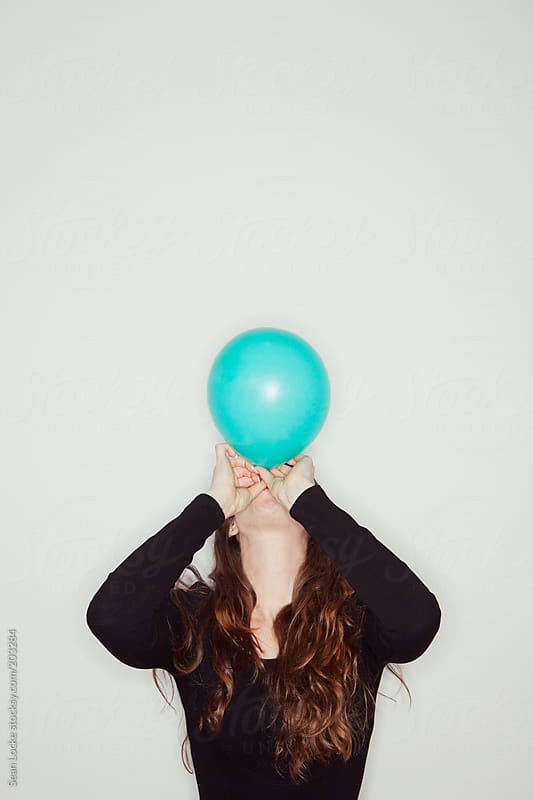 Portraits: Blowing Up A Balloon by Sean Locke for Stocksy United
