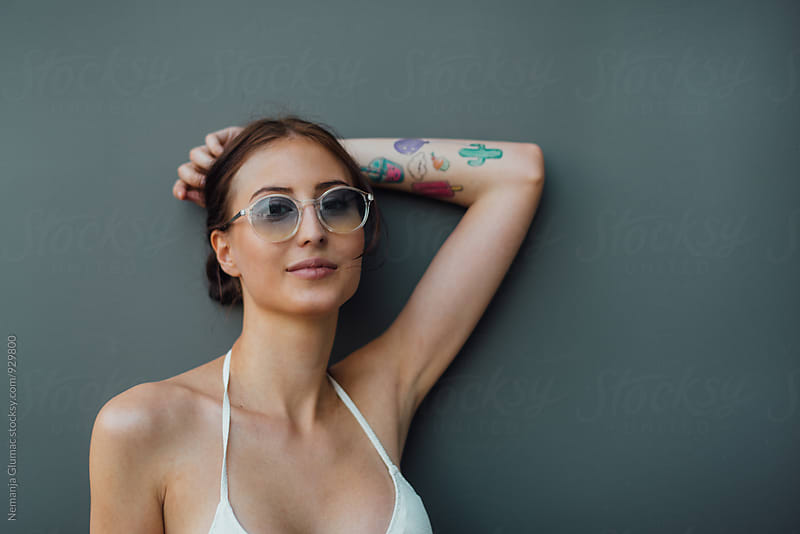 Portrait of a Pretty Brunette Woman With Sunglasses And Tattoos by Nemanja Glumac for Stocksy United