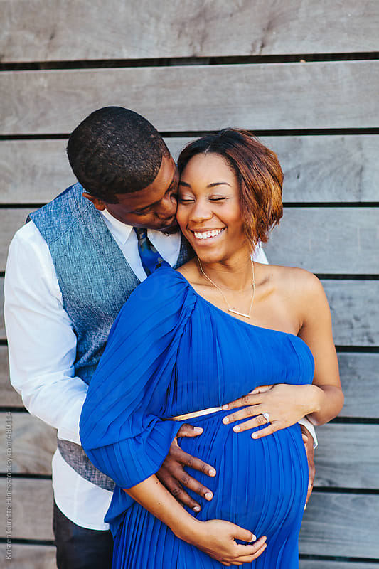 A happy young couple, celebrating pregnancy.  by Kristen Curette Hines for Stocksy United