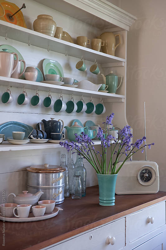 Collection of vintage English Pottery on kitchen dresser by Rowena Naylor for Stocksy United