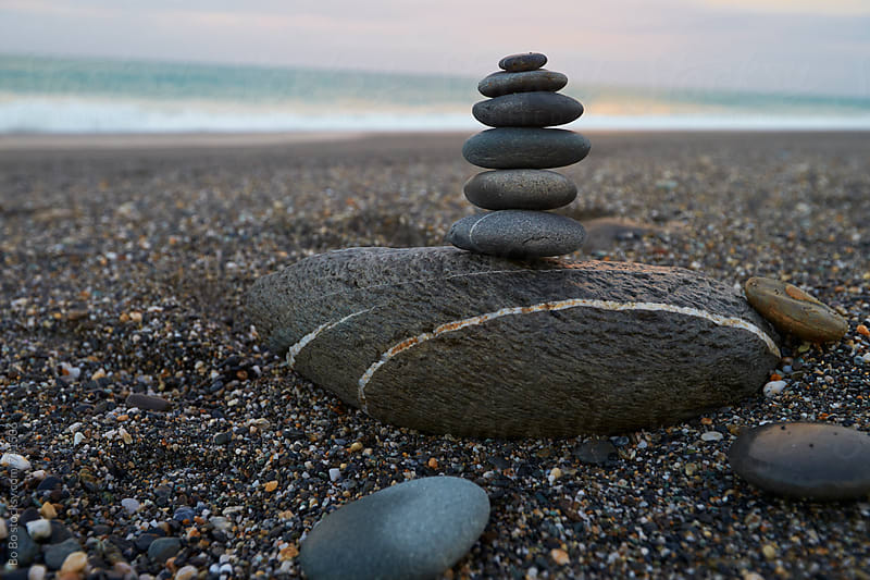 stack of stone on the beach by Bo Bo for Stocksy United