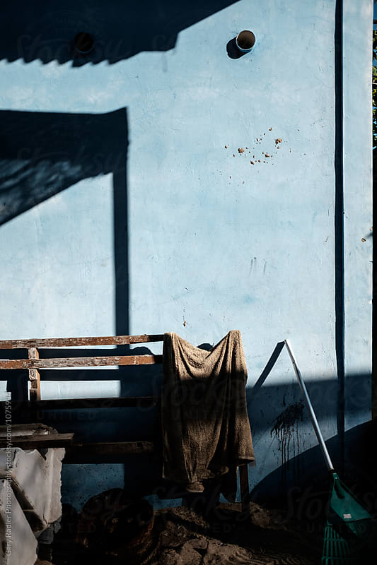 Objects Leaning on a Blue Wall in Bali by Gary Radler Photography for Stocksy United