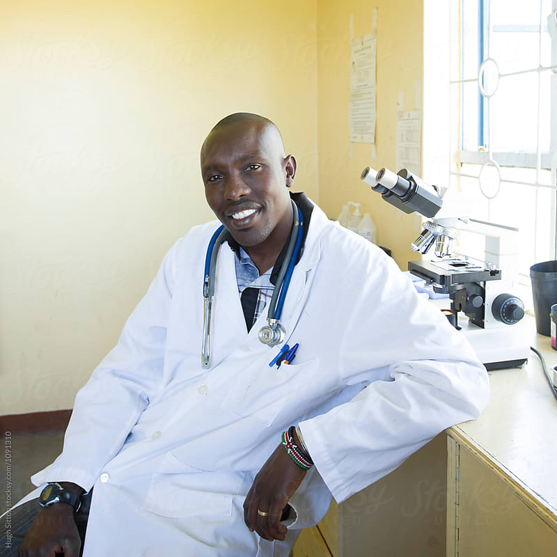 Portrait of Doctor in clinic. Kenya. Africa. by Hugh Sitton for Stocksy United